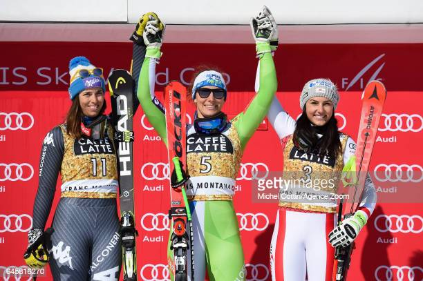 Elena Curtoni of Italy takes 2nd place Ilka Stuhec of Slovenia takes 1st place Stephanie Venier of Austria takes 3rd place during the Audi FIS Alpine...