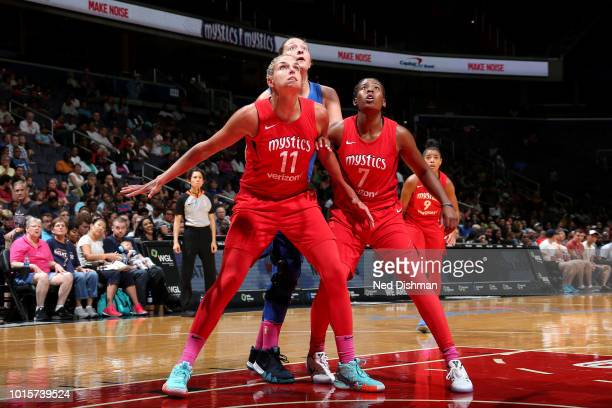 Elena Delle Donne and Ariel Atkins of the Washington Mystics box out Theresa Plaisance of the Dallas Wings on August 12 2018 at the Capital One Arena...