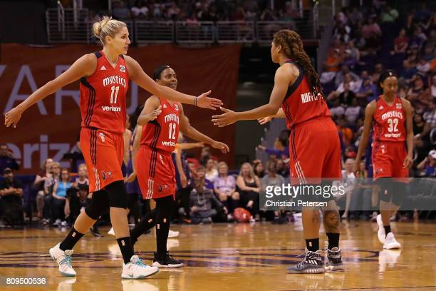 Elena Delle Donne and Ivory Latta of the Washington Mystics high five Tierra RuffinPratt after scoring against the Phoenix Mercury during the second...