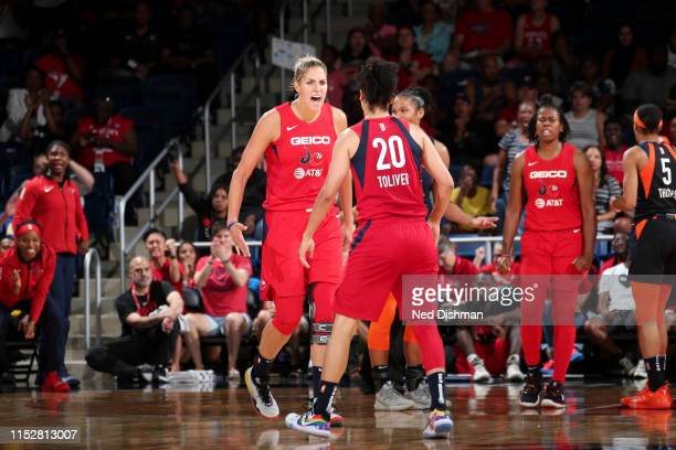 Elena Delle Donne and Kristi Toliver of the Washington Mystics react to a play during the game against the Connecticut Sun on June 29 2019 at the St...