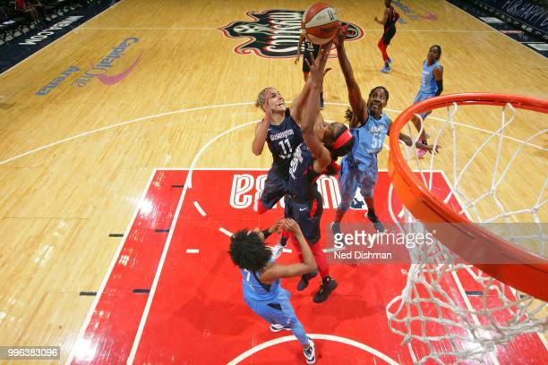 Elena Delle Donne and LaToya Sanders of the Washington Mystics go up for a rebound against Jessica Breland of the Atlanta Dream on July 11 2018 at...