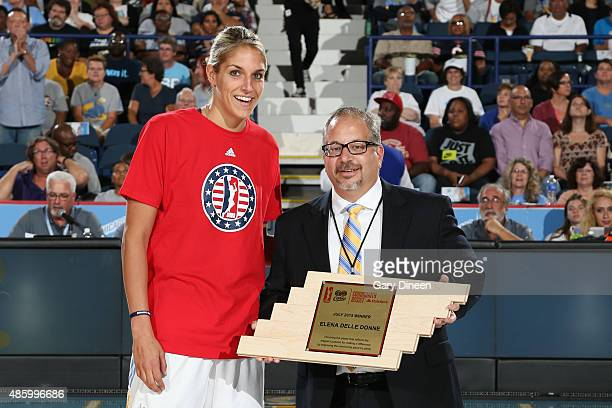 Elena Delle Donne of the Chicago Sky is presented with the WNBA Cares Community Assist Award Presented by State Farm, for the month of July, by Adam...