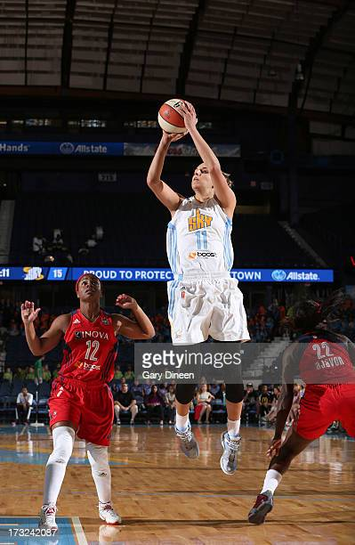 Elena Delle Donne of the Chicago Sky shoots over Ivory Latta and Matee Ajavon of the Washington Mystics during the game on July 10 2013 at the...