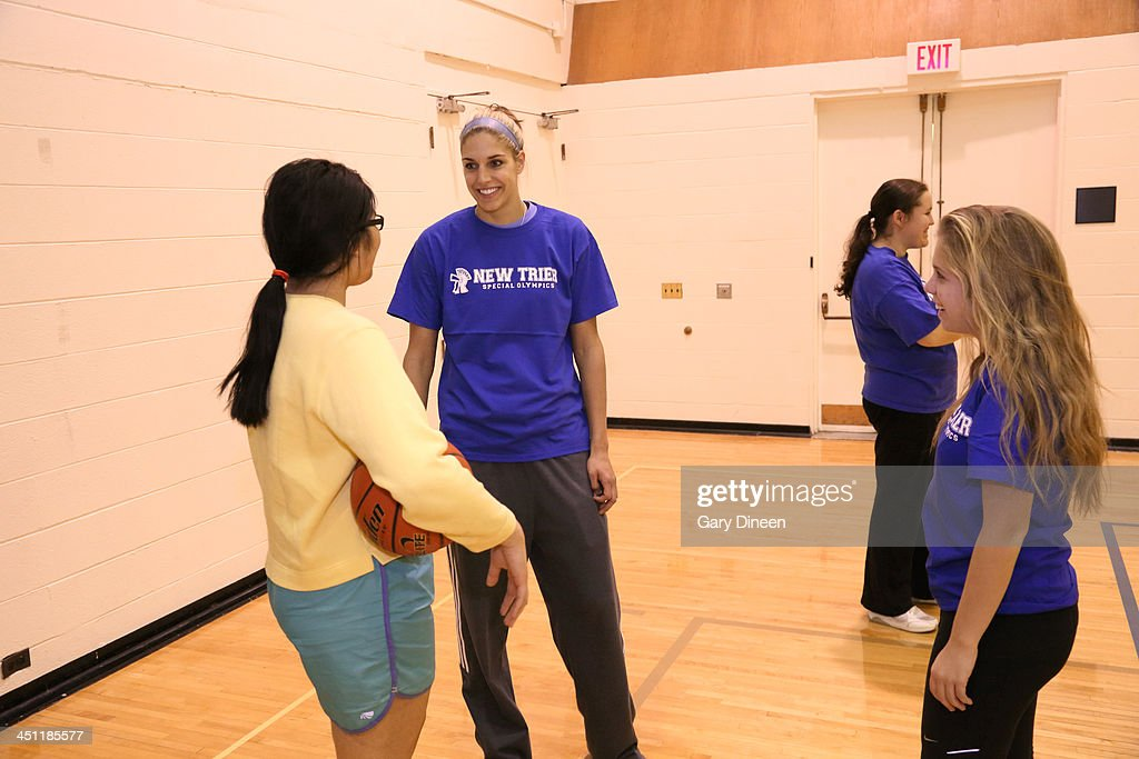 Elena Delle Donne of the Chicago Sky visits with Special Olympics athletes during a basketball skills clinic on November 12, 2013 at New Trier Township High School in Winnetka, Illinois.