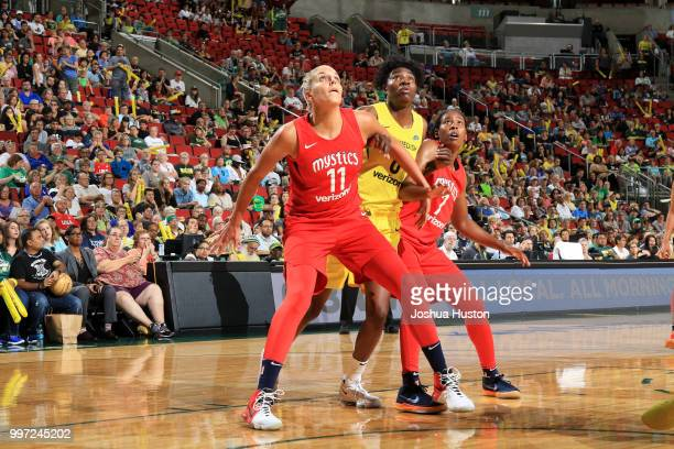 Elena Delle Donne of the Washington Mystics and Ariel Atkins of the Washington Mystics box out Natasha Howard of the Seattle Storm on July 8 2018 at...