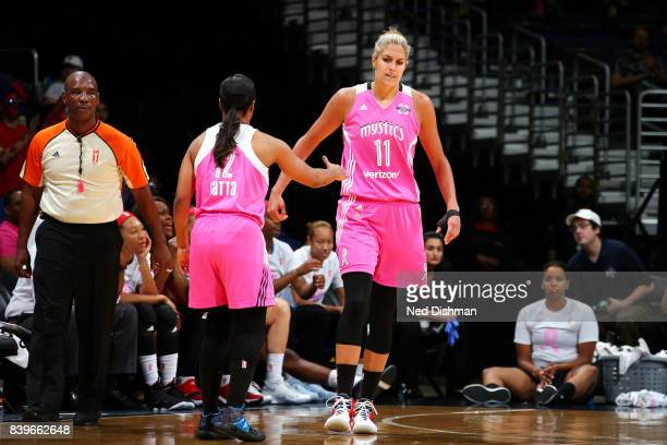 Elena Delle Donne of the Washington Mystics and Ivory Latta of the Washington Mystics high five each other during the game against the Dallas Wings...