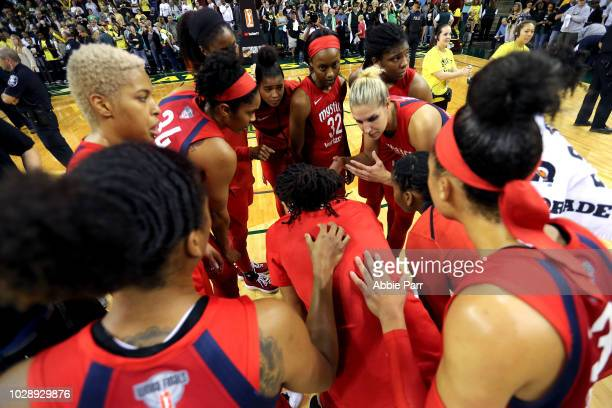 Elena Delle Donne of the Washington Mystics and teammates discuss play after falling 8976 to the Seattle Storm during game one of the WNBA Finals at...