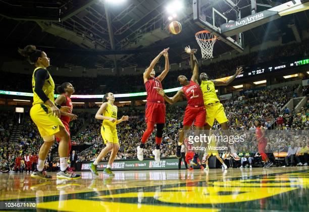 Elena Delle Donne of the Washington Mystics Ariel Atkins and Natasha Howard of the Seattle Storm vie for a rebound at the Storm basket during the...
