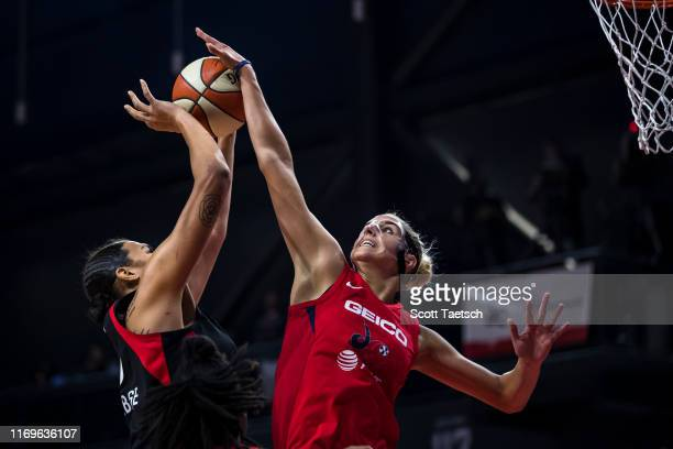 Elena Delle Donne of the Washington Mystics blocks a shot against Liz Cambage of the Las Vegas Aces during the first half of Game Two of the 2019...