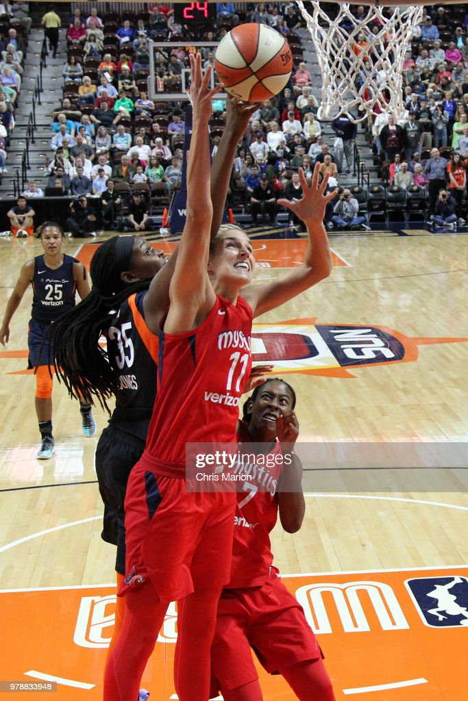 Elena Delle Donne #11 of the Washington Mystics blocks against Jonquel Jones #35 of the Connecticut Sun during a WNBA game on June 13, 2018 at the Mohegan Sun Arena in Uncasville, Connecticut.