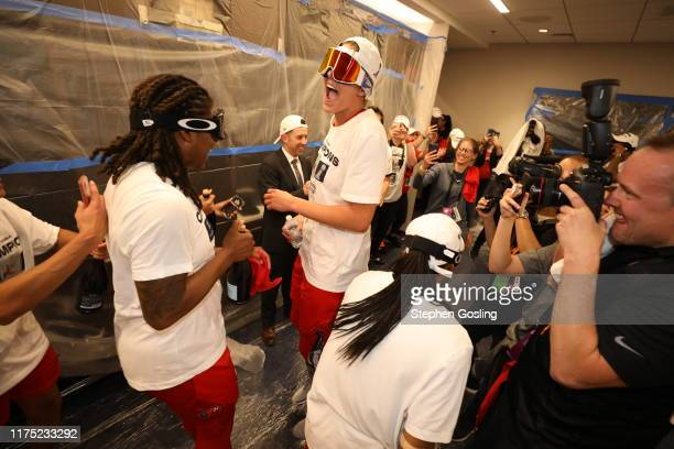 Elena Delle Donne of the Washington Mystics celebrates in the locker room after winning the 2019 WNBA Finals against the Connecticut Sun during Game...