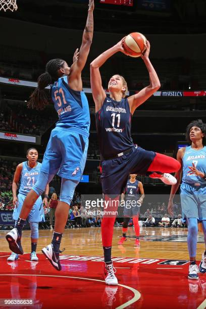 Elena Delle Donne of the Washington Mystics drives to the basket and shoots the ball against the Atlanta Dream on July 11, 2018 at Capital One Arena...