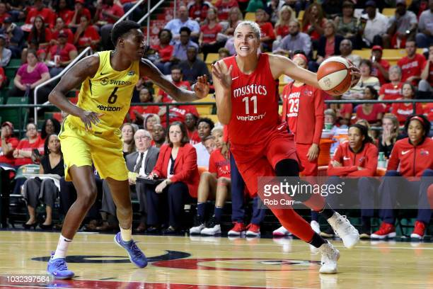 Elena Delle Donne of the Washington Mystics drives to the basket against Natasha Howard of the Seattle Storm in the second half during game three of...