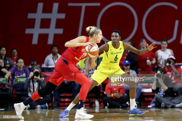 Elena Delle Donne of the Washington Mystics drives to the basket against Natasha Howard of the Seattle Storm in the first half during game three of...