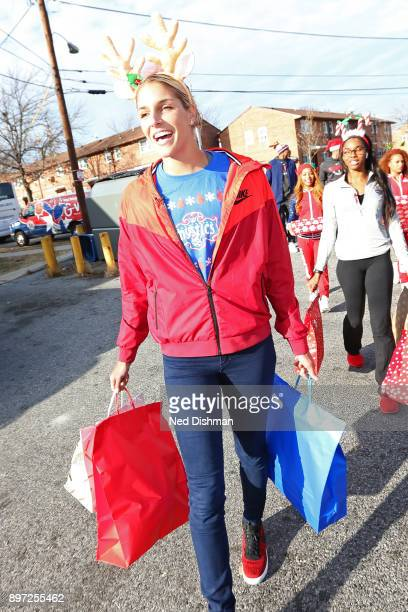 Elena Delle Donne of the Washington Mystics helps hands out presents during the Washington Wizards Holiday Event on December 20 2017 in Washington DC...