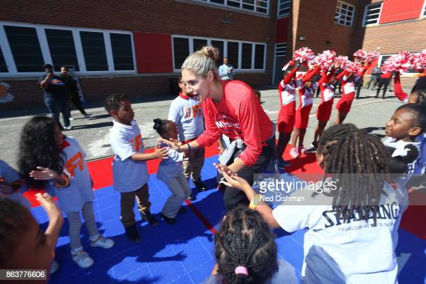 Elena Delle Donne of the Washington Mystics high fives kids of Hendley Elementary school during a court dedication on October 17 2017 at Hendley...