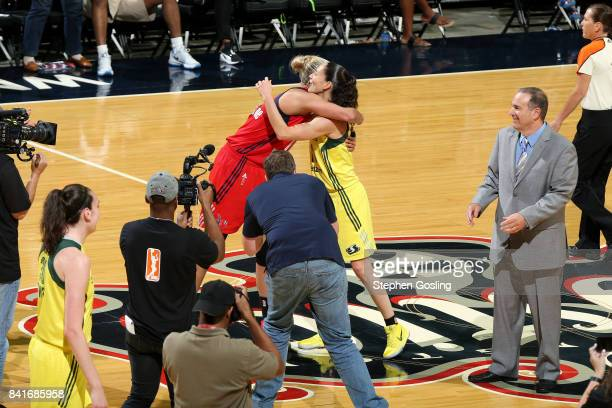 Elena Delle Donne of the Washington Mystics shares a hug with Sue Bird of the Seattle Storm after breaking the WNBA Career assist record during a...