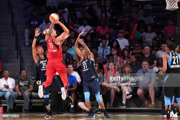 Elena Delle Donne of the Washington Mystics shoots the ball against Jessica Breland of the Atlanta Dream and Angel McCoughtry of the Atlanta Dream on...