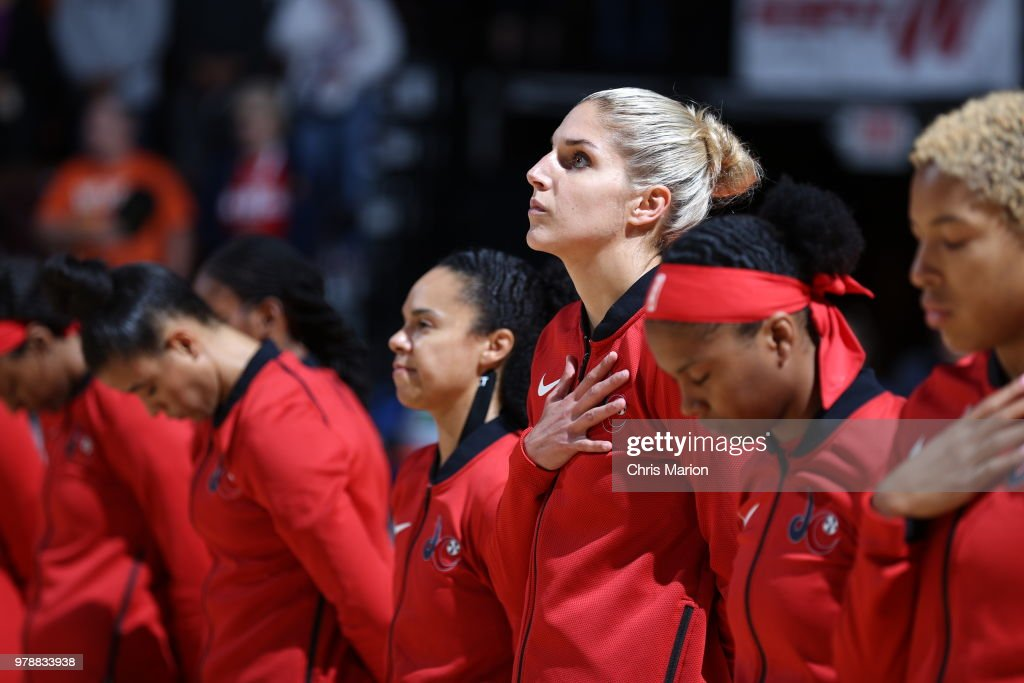 Elena Delle Donne #11 of the Washington Mystics stands for the national anthem before the game against the Connecticut Sun on June 13, 2018 at the Mohegan Sun Arena in Uncasville, Connecticut.