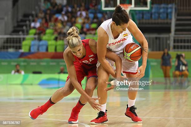 Elena Delle Donne of United States and Laura Nicholls of Spain collide as the chase a loose ball during the women's basketball game on Day 3 of the...