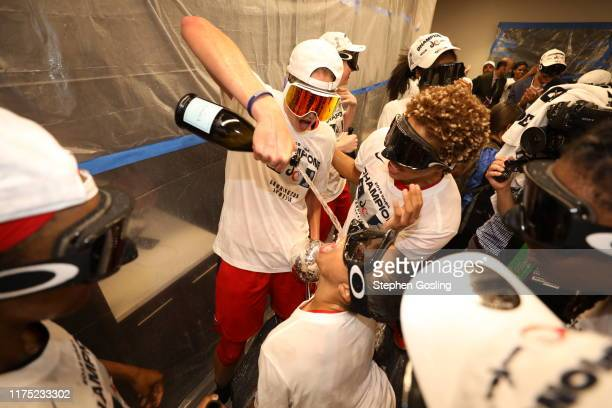 Elena Delle Donne of Washington Mystics celebrates with Natasha Cloud in the locker room after winning the 2019 WNBA Finals against the Connecticut...
