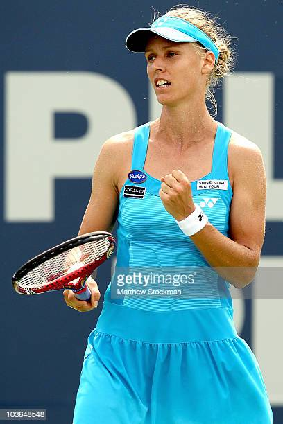 Elena Dementieva of Russia celebrates a point against Marion Bartoli of France during the Pilot Pen tennis tournament at the Connecticut Tennis...