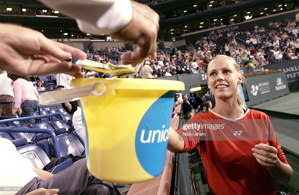 Elena Dementieva of Russia collects money from fans during the ATP All-Star Rally for Relief at the Pacific Life Open at the Indian Wells Tennis Garden on March 11, 2005 in Indian Wells, California.