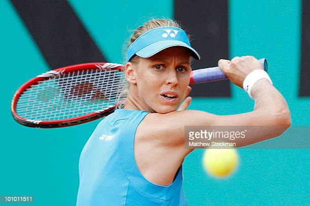 Elena Dementieva of Russia plays a backhand during the women's singles second round match between Elena Dementieva of Russia and A Medina Garrigues...