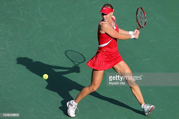Elena Dementieva of Russia plays a backhand in the Women's Singles final match against Caroline Wozniacki of Denmark on day seven of the Toray Pan...