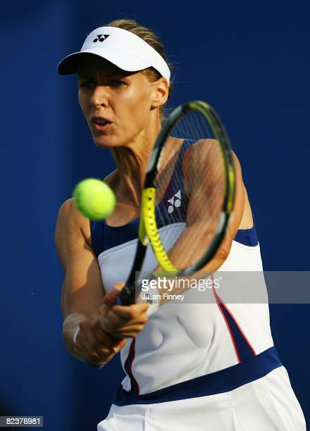 Elena Dementieva of Russia returns a backhand to Vera Zvonareva of Russia during the women's singles semifinal at the Olympic Green Tennis Center on...