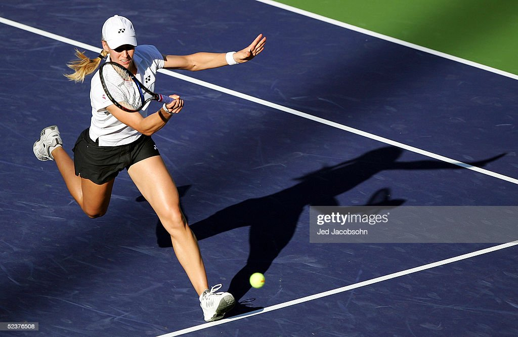 Elena Dementieva of Russia returns a shot against Abigail Spears of the United States during the Pacific Life Open at the Indian Wells Tennis Garden on March 11, 2005 in Indian Wells, California.