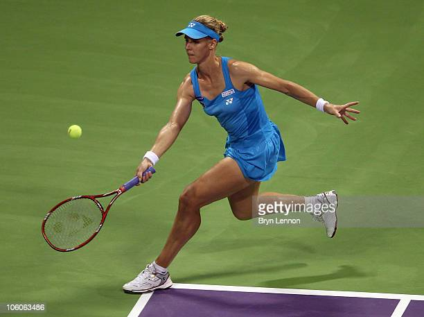Elena Dementieva of Russia returns a shot to Caroline Wozniacki of Denmark during day one of the WTA Championships at the Khalifa Tennis Complex on...
