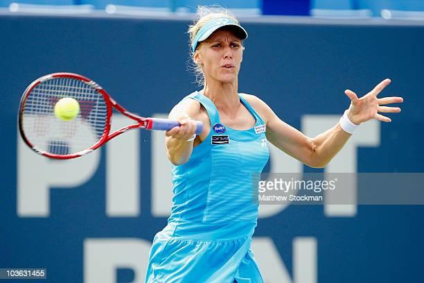 Elena Dementieva of Russia returns a shot to Kateryna Bondarenko of Ukraine during the Pilot Pen tennis tournament at the Connecticut Tennis Center...