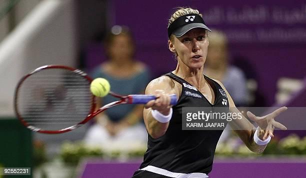 Elena Dementieva of Russia returns to Svetlana Kuznetsova of Russia during their WTA Championships tennis match at the Khalifa International Tennis...