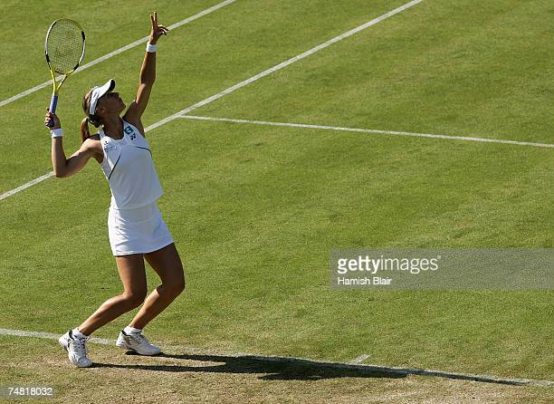 Elena Dementieva of Russia serves in her match against Katie O'Brien of Great Britain during the International Women's Open Tennis Championships at...