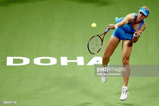 Elena Dementieva of Russia serves to Samantha Stosur of Australia during day three of the WTA Championships at the Khalifa Tennis Complex on October...