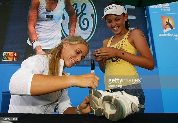 Elena Dementieva of Russia signs autographs for fans at the live site during day two of the 2009 Medibank International at the Sydney Olympic Park...
