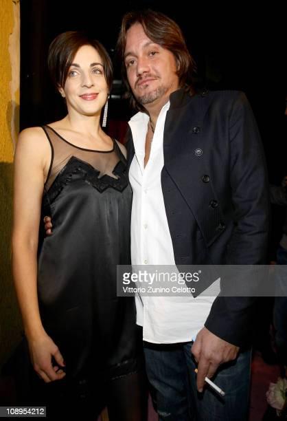 Elena Di Cioccio and Cristiano De Andre attend the John Galliano perfume launch held at the Plastic on February 9 2011 in Milan Italy