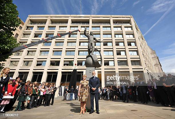 Elena Gagarina daughter of Russian cosmonaut Yuri Gargarin poses for pictures with Britain's Prince Michael of Kent after the unveiling of a statue...
