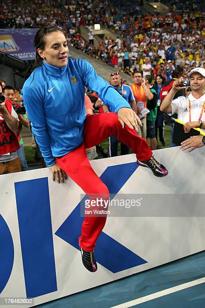 Elena Isinbaeva of Russia celebrates winning gold in the Women's pole vault final during Day Four of the 14th IAAF World Athletics Championships...