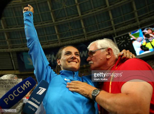 Elena Isinbaeva of Russia celebrates winning gold with her coach Evgeny Trofimov in the Women's pole vault final during Day Four of the 14th IAAF...