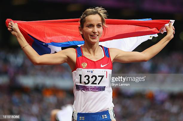 Elena Ivanova of Russia celebrates as she wins gold in the Women's 100m T36 Final on day 10 of the London 2012 Paralympic Games at Olympic Stadium on...