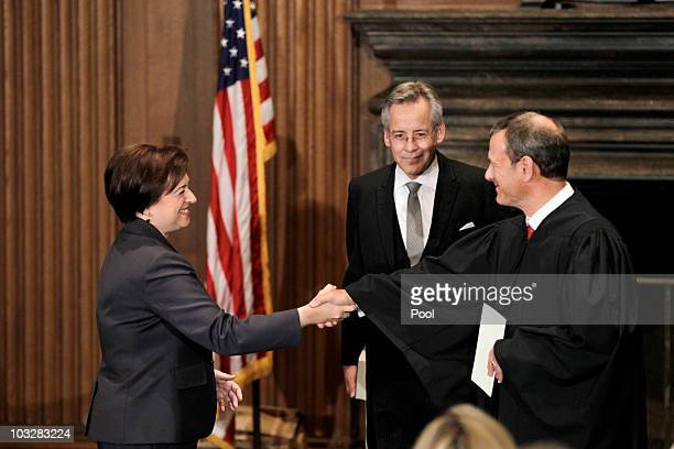 Elena Kagan is congratulated by Chief Justice John Roberts after becoming the Supreme Court's newest member as Jeffrey Minear, counselor to the chief...