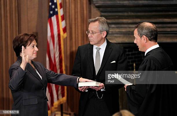 Elena Kagan is sworn in as the Supreme Court's newest member as Chief Justice John Roberts administers the judicial oath, and Jeffrey Minear,...