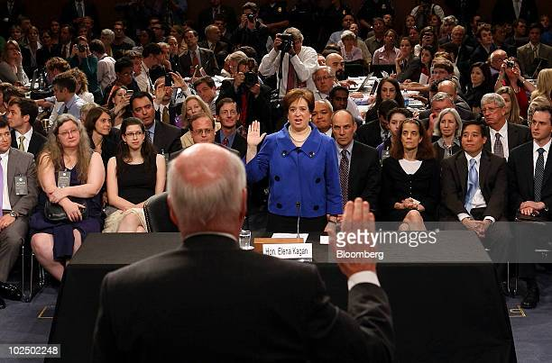 Elena Kagan nominee for the US Supreme Court center is sworn in by Senator Patrick Leahy a Democrat from Vermont foreground during her Senate...