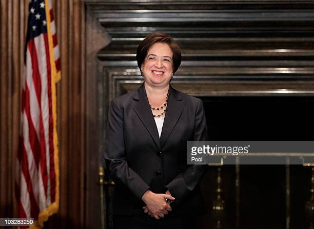 Elena Kagan smiles after being sworn in as the Supreme Court's newest member by Chief Justice John Roberts at the Supreme Court Building August 7,...