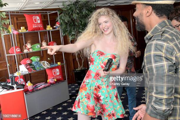 Elena Kampouris and Kevin Carroll test their skills on Super Smash Bros Ultimate for Nintendo Switch at the Variety Studio at ComicCon 2018 on July...