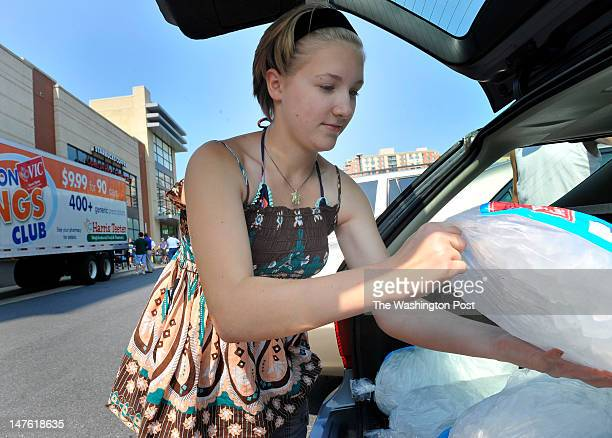 Elena Kervitsky loaded her family's ice they pickedup at the Harris Teeter's free ice distribution to shoppers and anyone passingby at the chain's...