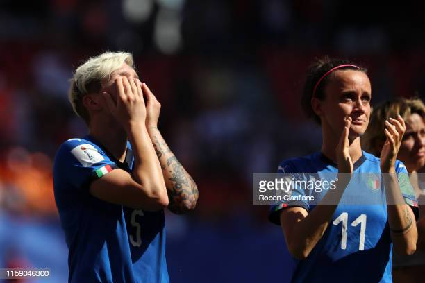 Elena Linari of Italy reacts as Barbara Bonansea of Italy applauds fans after the 2019 FIFA Women's World Cup France Quarter Final match between...