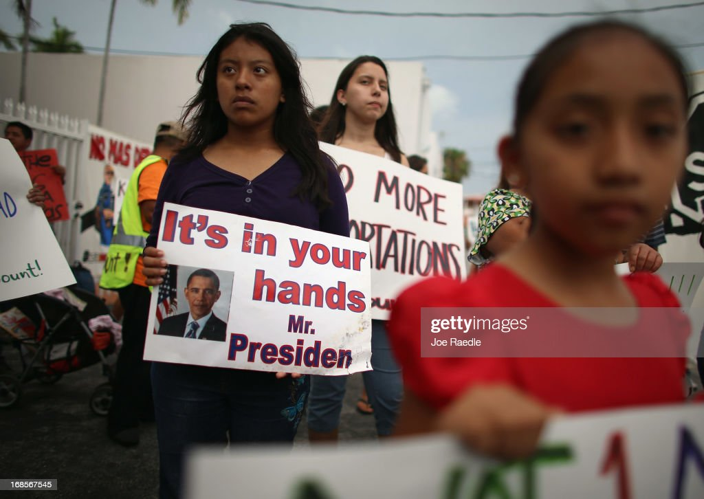 Elena Marquez (L) holds a sign reading 'it's in your hands Mr. President' as she and others participate in a rally calling on the President Barack Obama to immediately suspend deportations and for Congress to pass an immigration reform that's inclusive of all 11 million undocumented people in the U.S. on May 11, 2013 in Homestead, Florida. The rally is part of what is being called a rolling fast in different places throughout the nation over the course of the next two months to bring what organizers say is a moral, prophetic voice to the immigration debate.